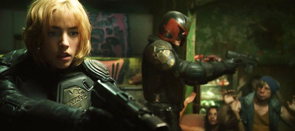 Anderson (Olivia Thirlby) and Dredd (Karl Urban) take down a drug den.
